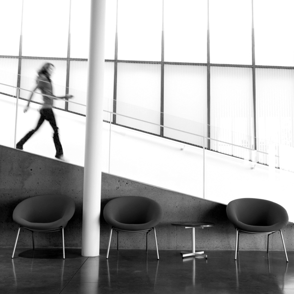 Woman walking down stairs in office building